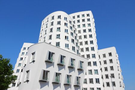 frank: DUSSELDORF, GERMANY - JULY 8: Neuer Zollhof building on July 8, 2013 in Dusseldorf, Germany. The building was designed by famous Frank Gehry and completed in 1998.