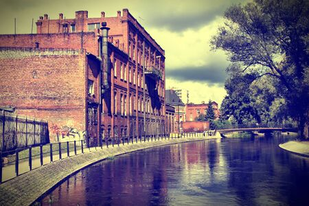 cross processed: Poland - Bydgoszcz, city in Kuyavia (Kujawy) region. Old factory in water canal borough called Bydgoszcz Venice. Cross processed retro color style.