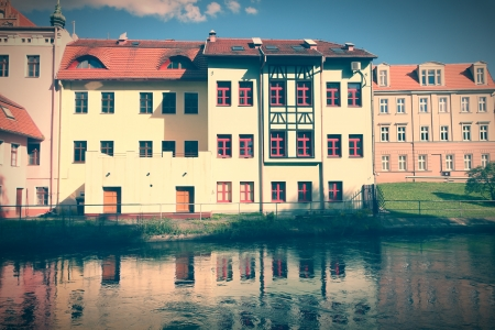 cross processed: Poland - Bydgoszcz, city in Kuyavia (Kujawy) region. Apartment buildings in water canal borough called Bydgoszcz Venice. Cross processed retro color style.