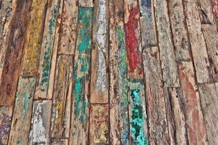 Old wooden flooring with peeling paint. Wood background texture. photo