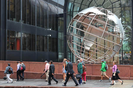 willis: CHICAGO, USA - JUNE 26, 2013: People walk by Willis Tower globe sculpture in Chicago. Chicago is the 3rd most populous US city with 2.7 million residents (8.7 million in its urban area).