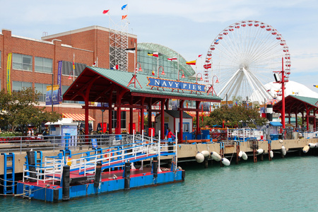 navy pier: CHICAGO, USA - JUNE 26, 2013: People visit famous Navy Pier in Chicago. The 3,300-foot pier built in 1916 is one of most recognized Chicago landmarks. Editorial