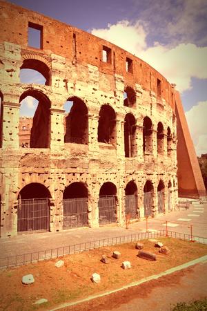 cross processed: Rome, Italy. Famous Colosseum, Flavian Amphitheatre. Ancient landmark. Cross processed color style - retro image tone. Stock Photo