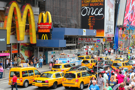 new york times: NEW YORK, USA - JULY 3, 2013: Taxis drive along Times Square in New York. Times Square is one of most recognized landmarks in the world. More than 300,000 people pass through Times Square daily.