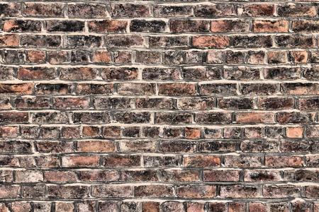 urban decline: Grungy brick wall background texture. Architecture detail abstract. Flat surface. Stock Photo