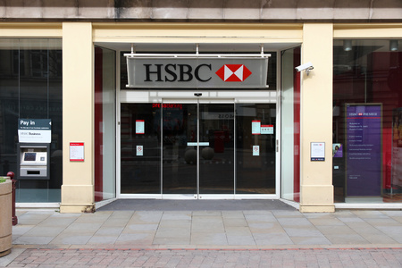 bank branch: MANCHESTER, UK - APRIL 21, 2013: Exterior view of HSBC Bank branch in Manchester, UK. HSBC is one of largest bank groups, holding assets of $2.69 trillion worldwide (2012).