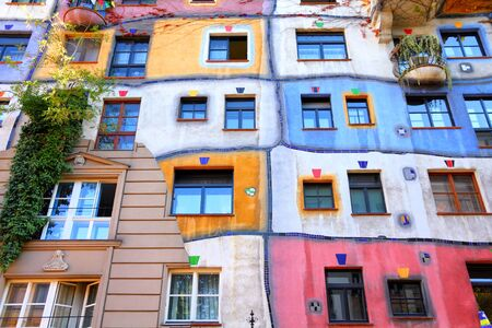 expressionist: VIENNA, AUSTRIA - SEPTEMBER 6, 2011: Hundertwasser Haus in Vienna. The iconic building was finished in 1985 and is one of finest examples of expressionist architecture.