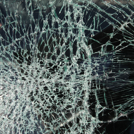 Broken car windshield made of laminated glass. Square composition. photo