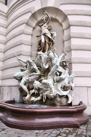 burg: Vienna, Austria - statue in Neue Burg (part of Hofburg palace) facade. Michaelerplatz side.