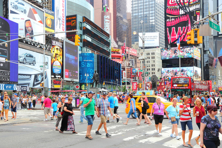 new york times: NEW YORK, USA - JULY 4, 2013: People visit Times Square in New York. Times Square is one of most recognized landmarks in the world. More than 300,000 people pass through Times Square daily.