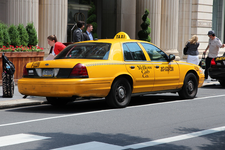 1 person: PHILADELPHIA, USA - JUNE 11, 2013: Unidentified person exits taxi cab in Philadelphia. As of 2012 Philadelphia is the 5th most populous city in the US with 1,547,607 citizens.