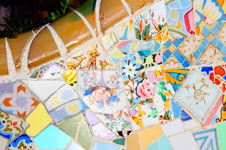 trencadi: BARCELONA, SPAIN - NOVEMBER 6: Ceramic art in Park Guell on November 6, 2012 in Barcelona, Spain. It was built in 1900-14 and  is part of the UNESCO World Heritage Site Works of Antoni Gaudi.