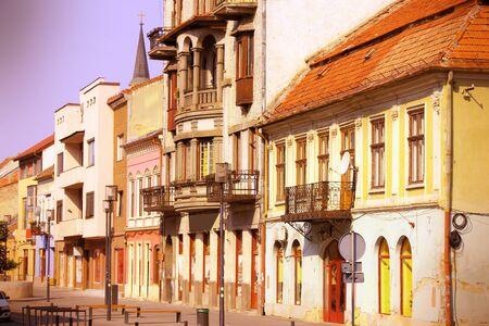 cluj: Cluj-Napoca, town in Transylvania region of Romania. Second biggest Romanian city. Eroilor avenue architecture. Cross processing color tone - filtered retro style.