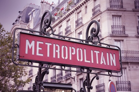 france station: Paris, France - retro metro station sign. Subway train entrance. Retro filtered look - cross processing color tone.