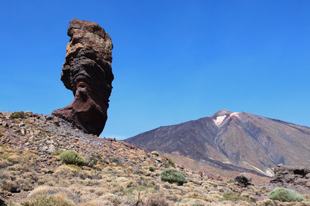 Tenerife, Canary Islands, Spain - volcano Teide National Park, UNESCO World Heritage Site. Roques de Garcia and Mount Teide - famous Finger of God rock (Roque Cinchado). photo