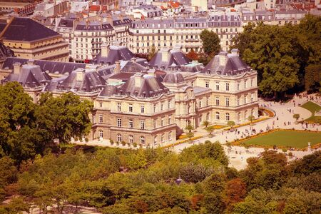 cross processed: Paris, France - aerial city view with Luxembourg Palace. UNESCO World Heritage Site. Cross processed colors style - filtered tone retro image.