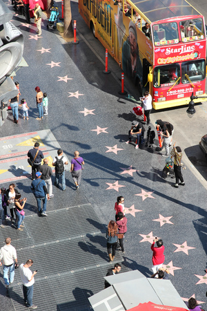 north hollywood: LOS ANGELES, USA - APRIL 5, 2014: People walk famous Walk of Fame in Hollywood. Hollywood Walk of Fame features more than 2,500 stars with inscribed celebrity names.