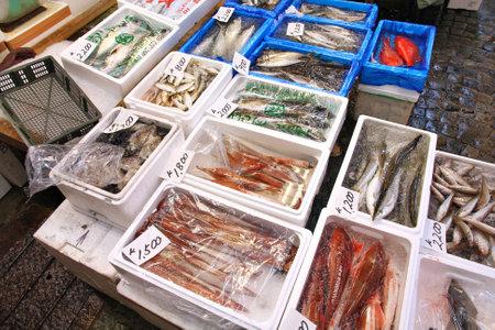 TOKYO, JAPAN - MAY 11, 2012: Seafood choice at famous Tsukiji Fish Market in Tokyo. It is the biggest wholesale fish and seafood market in the world.