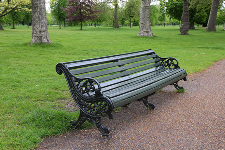 hyde: London, United Kingdom - cast iron bench in famous Hyde Park
