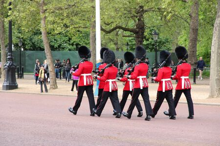 st jamess: LONDON, UK - MAY 16, 2012: Guards march for the Changing of the Guard in St. Jamess Park in London. It is one of most recognized tourism attractions worldwide.