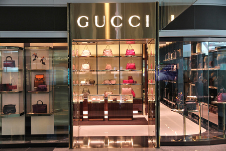 MUNICH, GERMANY - APRIL 1, 2014: Gucci store at Munich International Airport in Germany. The fashion company founded in 1921 is among most recognized luxury brands in the world.