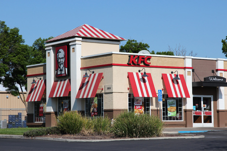 establishment states: FRESNO, UNITED STATES - APRIL 12, 2014: KFC fast food restaurant in Fresno, California. As of December 2013 KFC had 18,875 outlets in 118 countries.