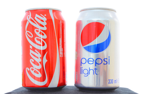 branded: WARSAW, POLAND - MAY 20, 2010: Coca-Cola and Pepsi canned soft drinks together. These drinks are part of legendary competition between Coca-Cola and PepsiCo beverage corporations.