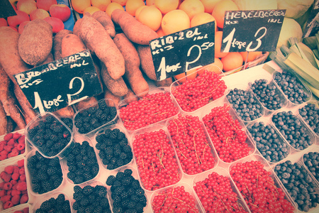 Fruit and vegetable stand at a marketplace in Vienna, Austria. Farmers market. Retro color style - cross processed colors tone. photo