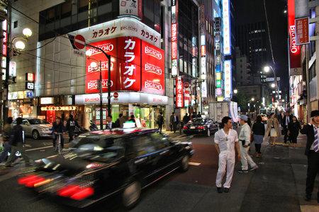 TOKYO, JAPAN - APRIL 13, 2012: People visit Yaesu neighborhood in Tokyo. Tokyo is the capital city of Japan, 35 million people live in its urban area.