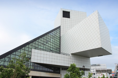 fames: CLEVELAND, USA - JUNE 29, 2013: Exterior view of Rock and Roll Hall of Fame in Cleveland. It is a famous museum established in 1983, depicting history of influential rock artists. Editorial