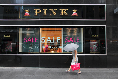 lvmh: NEW YORK, USA - JULY 1, 2013: Shopper walks by Thomas Pink store at 6th Avenue in New York. Thomas Pink luxury fashion company is part of famous LVMH Group.