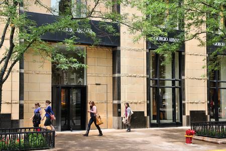magnificent mile: CHICAGO, USA - JUNE 26, 2013: Shoppers walk by Giorgio Armani fashion store at Magnificent Mile in Chicago. The Magnificent Mile is one of most prestigious shopping districts in the United States.