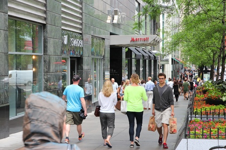 magnificent mile: CHICAGO, USA - JUNE 26, 2013: People walk the famous Magnificent Mile of Michigan Avenue in Chicago. It is Chicagos major shopping destination and one of USAs most recognized shopping areas.