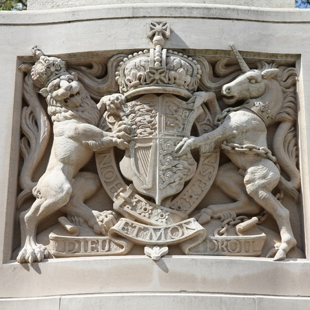 The Lion and the Unicorn - famous symbol of the United Kingdom. Sculpture in London. Square composition. photo