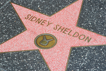 hollywood boulevard: LOS ANGELES, USA - APRIL 5, 2014: Sidney Sheldon star at famous Walk of Fame in Hollywood. Hollywood Walk of Fame features more than 2,500 stars with inscribed celebrity names.