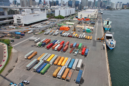 tonnes: TOKYO, JAPAN - MAY 11, 2012: Containers in Port of Tokyo in Tokyo. Port of Tokyo is one of busiest seaports in the Pacific Ocean basin with 100 million tonnes of cargo handled annually.