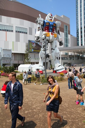 mecha: TOKYO, JAPAN - MAY 11, 2012: People visit Gundam robot replica in Odaiba,Tokyo. The sculpture is 18m tall and is the tallest replica of famous anime franchise robot, Gundam.