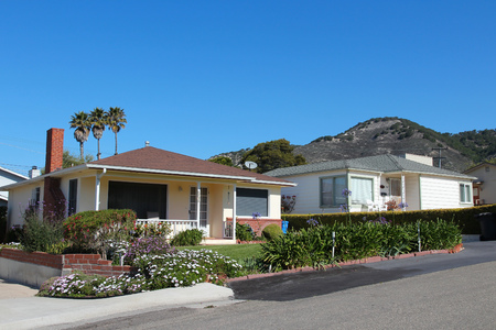 SAN LUIS OBISPO, UNITED STATES - APRIL 7, 2014: Generic California residential homes as seen from public road in San Luis Obispo county. Real estate rates in California have grown 105 percent since 1990.