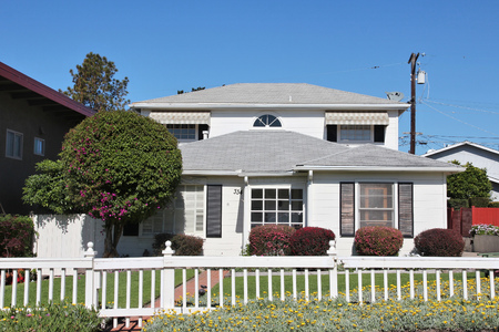 home grown: SAN LUIS OBISPO, UNITED STATES - APRIL 7, 2014: Generic California residential home as seen from public road in San Luis Obispo county. Real estate rates in California have grown 105 percent since 1990. Editorial