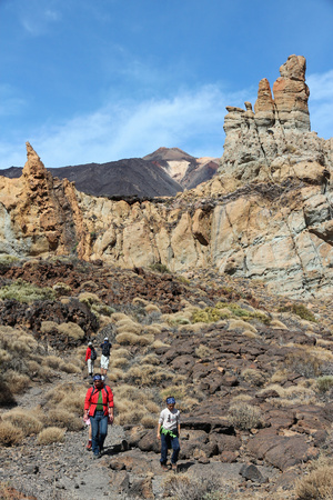 TENERIFE, SPAIN - OCTOBER 29, 2012: People hike in volcanic landscape of Teide National Park in Tenerife. The 18,990 hectare national park is listed as a UNESCO World Heritage Site.