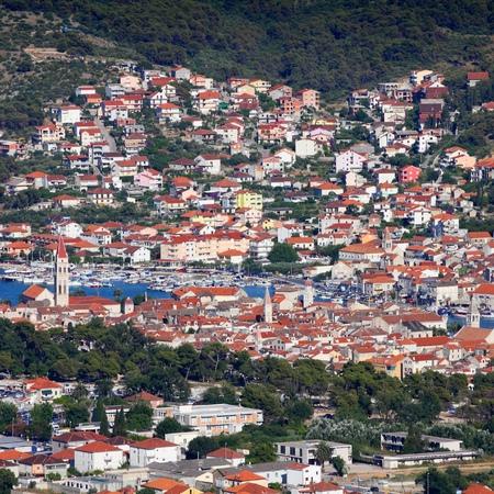 Croatia - aerial view of Trogir in Dalmatia (UNESCO World Heritage Site). Ciovo island in background. Square composition. Stock Photo