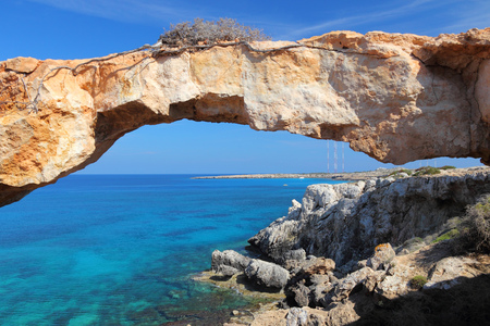 Cyprus - Mediterranean Sea coast. Natural rock bridge at Cape Greco near Ayia Napa.