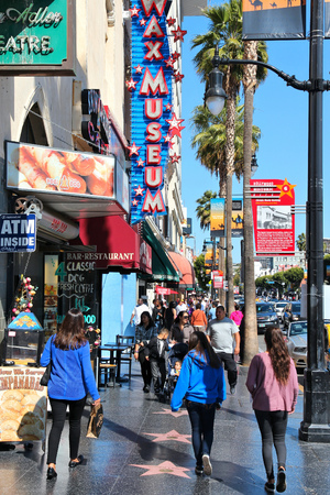 LOS ANGELES, USA - APRIL 5, 2014: People walk famous Walk of Fame in Hollywood. Hollywood Walk of Fame features more than 2,500 stars with inscribed celebrity names.