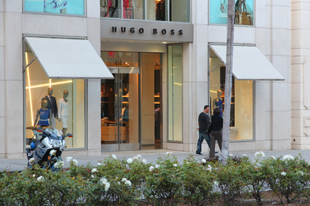 LOS ANGELES, USA - APRIL 5, 2014: Shoppers visit Hugo Boss store in Beverly Hills, Los Angeles. Hugo Boss is a German luxury fashion house 263 million EUR operating income in 2010. It exists since 1924.