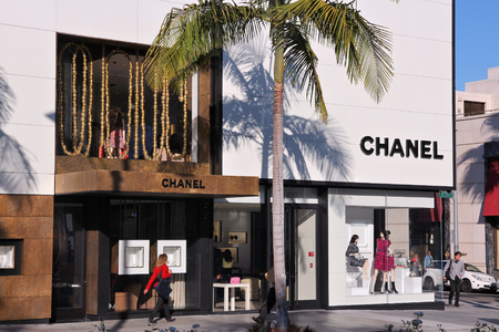 chanel: LOS ANGELES, USA - APRIL 5, 2014: Shoppers visit Chanel store in Beverly Hills, Los Angeles. The famous brand exists since 1909 and had 6.3 billion EUR revenue in 2012. Editorial
