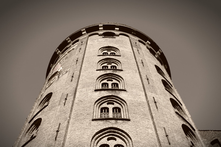 Copenhagen Old Town - capital city of Denmark. Famous vintage astronomical observatory - Round Tower (Rundetarn). Oresund region. Sepia tone - filtered monochrome photo. photo