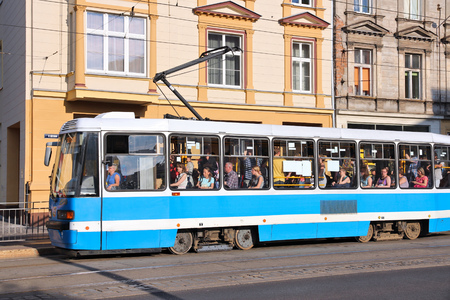 dolnoslaskie: WROCLAW, POLAND - JULY 6, 2014: People ride city tram in Wroclaw. There are 22 tram lines with total length of 258km in Wroclaw. Editorial