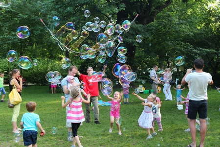 dolnoslaskie: WROCLAW, POLAND - JULY 6, 2014: Children play with soap bubbles in park in Wroclaw. Wroclaw is the 4th largest city in Poland with 632,067 people (2013). Editorial