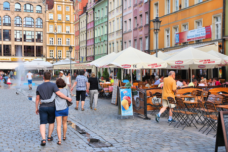 WROCLAW, POLAND - JULY 6, 2014: People visit Rynek (Market Square) in Wroclaw. Wroclaw is the 4th largest city in Poland with 632,067 people (2013).