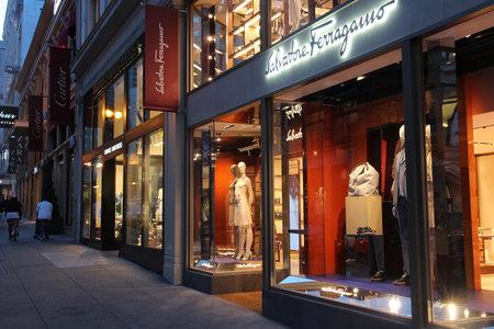 expensive: SAN FRANCISCO, USA - APRIL 8, 2014: People walk by Salvatore Ferragamo fashion store in San Francisco, USA. Salvatore Ferragamo has 550 brand fashion stores. Editorial